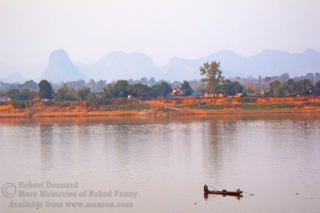 Smokey view of the karst across the Mekong in River.