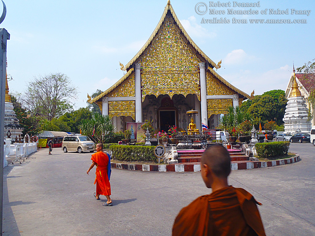 Monks in their saffron robes going to work.